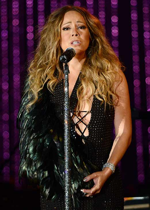 Mariah Carey, wearing a fancy sling, performs with the New York Philharmonic at the 2013 MLB All-Star Charity Concert, benefiting Hurricane Sandy relief efforts, in New York City&#39;s Central Park on July 13, 2013. She had recently suffered a shoulder injury during a music video shoot and had told her Twitter followers she would wear &#39;fashionable slings&#39; for the next two weeks. <span class=meta>(Humberto Carreno &#47; startraksphoto.com)</span>