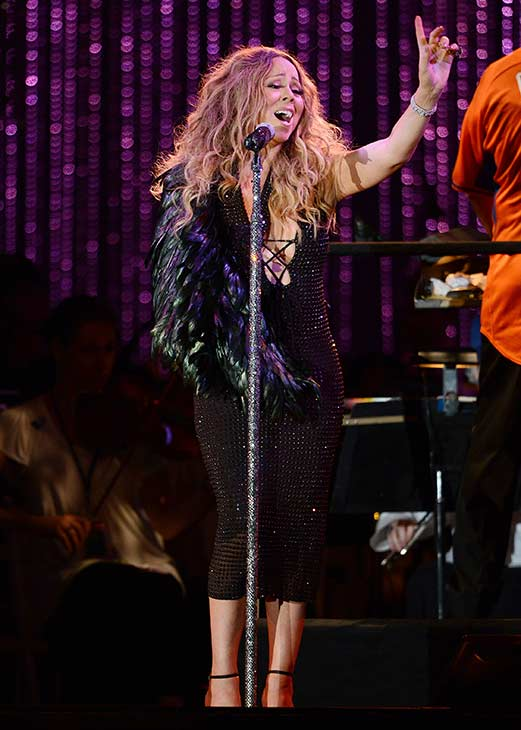"<div class=""meta image-caption""><div class=""origin-logo origin-image ""><span></span></div><span class=""caption-text"">Mariah Carey, wearing a fancy sling, performs with the New York Philharmonic at the 2013 MLB All-Star Charity Concert, benefiting Hurricane Sandy relief efforts, in New York City's Central Park on July 13, 2013. She had recently suffered a shoulder injury during a music video shoot and had told her Twitter followers she would wear 'fashionable slings' for the next two weeks. (Humberto Carreno / startraksphoto.com)</span></div>"