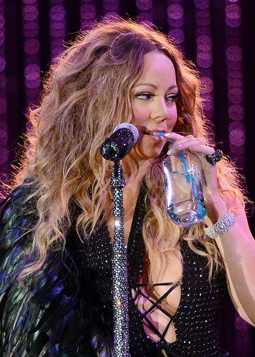 "<div class=""meta ""><span class=""caption-text "">Mariah Carey, wearing a fancy sling, drinks a Fiji water handed to her by an assistant as she performs with the New York Philharmonic at the 2013 MLB All-Star Charity Concert, benefiting Hurricane Sandy relief efforts, in New York City's Central Park on July 13, 2013. She had recently suffered a shoulder injury during a music video shoot and had told her Twitter followers she would wear 'fashionable slings' for the next two weeks. (Humberto Carreno / startraksphoto.com)</span></div>"