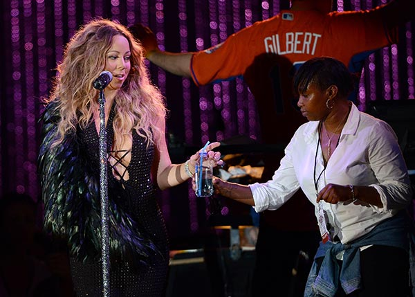 Mariah Carey, wearing a fancy sling, is helped by an assistant as she performs with the New York Philharmonic at the 2013 MLB All-Star Charity Concert, benefiting Hurricane Sandy relief efforts, in New York City&#39;s Central Park on July 13, 2013. She had recently suffered a shoulder injury during a music video shoot and had told her Twitter followers she would wear &#39;fashionable slings&#39; for the next two weeks. <span class=meta>(Humberto Carreno &#47; startraksphoto.com)</span>