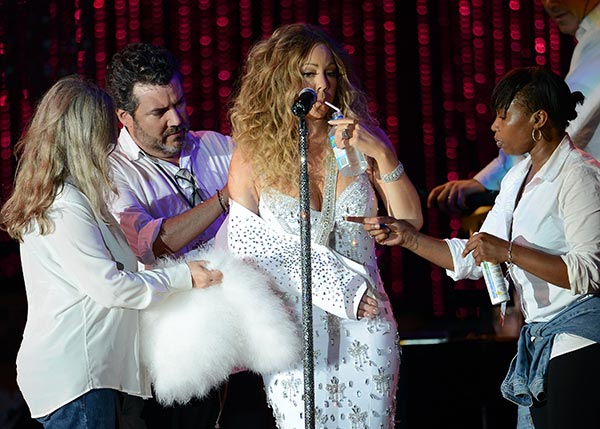 "<div class=""meta image-caption""><div class=""origin-logo origin-image ""><span></span></div><span class=""caption-text"">Mariah Carey, wearing a fancy sling, is helped by assistants as she performs with the New York Philharmonic at the 2013 MLB All-Star Charity Concert, benefiting Hurricane Sandy relief efforts, in New York City's Central Park on July 13, 2013. She had recently suffered a shoulder injury during a music video shoot and had told her Twitter followers she would wear 'fashionable slings' for the next two weeks. (Humberto Carreno / startraksphoto.com)</span></div>"