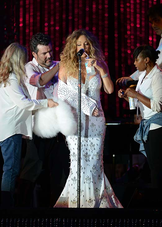 "<div class=""meta ""><span class=""caption-text "">Mariah Carey, wearing a fancy sling, is helped by assistants as she performs with the New York Philharmonic at the 2013 MLB All-Star Charity Concert, benefiting Hurricane Sandy relief efforts, in New York City's Central Park on July 13, 2013. She had recently suffered a shoulder injury during a music video shoot and had told her Twitter followers she would wear 'fashionable slings' for the next two weeks. (Humberto Carreno / startraksphoto.com)</span></div>"