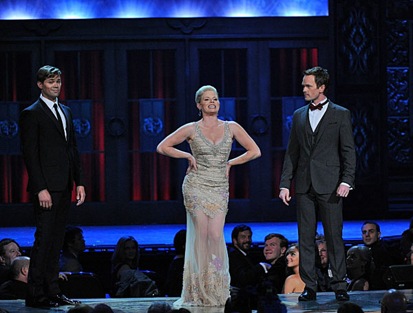 "<div class=""meta ""><span class=""caption-text "">Megan Hilty of 'Smash' performs with Neil Patrick Harris and Andrew Rannells  Andrew Rannells, Megan Hilty, and Neil Patrick Harris perform during the 2013 Tony Awards at Radio City Music Hall in New York City, Sunday, June 9.  Hilty -- who currently stars on NBC's musical television series 'Smash' -- has appeared on Broadway in the long-running 2003 musical 'Wicked,' as well as the 2009 comedy '9 to 5.' (CBS / Heather Wines)</span></div>"