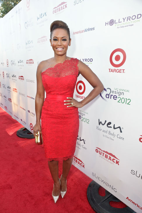 "<div class=""meta ""><span class=""caption-text "">Melanie Brown, aka Mel B. of the Spice Girls and a 'Dancing With The Stars' season 5 finalist, attends the HollyRod Foundation's 14th Annual Design Care event on July 21, 2012 in Malibu, California. Mel B. is wearing a red, one shoulder lace Romona Keveza RTW Spring 2012 dress, gold Christian Louboutin pumps and an Alexander McQueen clutch. (Vivien Killilea / WireImage)</span></div>"