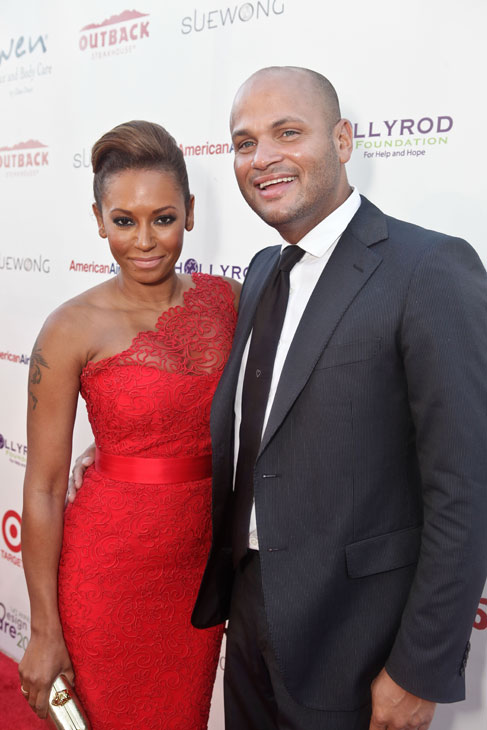 Melanie Brown, aka Mel B. of the Spice Girls and a &#39;Dancing With The Stars&#39; season 5 finalist, and husband Stephen Belafonte attend the HollyRod Foundation&#39;s 14th Annual Design Care event on July 21, 2012 in Malibu, California. Mel B. is wearing a red, one shoulder lace Romona Keveza RTW Spring 2012 dress, gold Christian Louboutin pumps and an Alexander McQueen clutch. Actress Holly Robinson Peete and her husband and NFL quarterback Rodney Peete co-founded the HollyRod Foundation in 1997. The group is dedicated to providing help and hope to those living with autism and Parkinson&#39;s disease. <span class=meta>(Vivien Killilea &#47; WireImage)</span>
