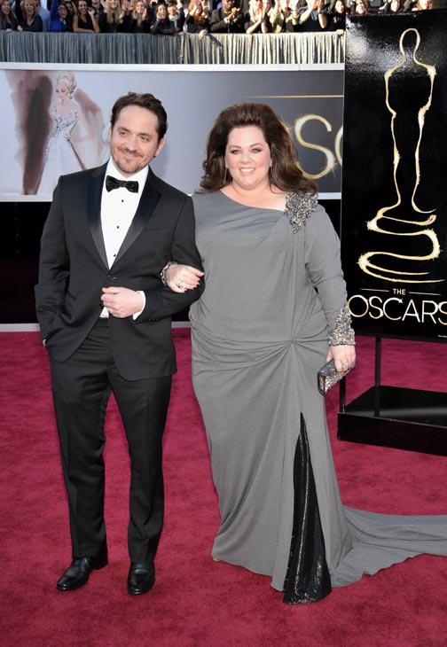 Actors Ben Falcone and Melissa McCarthy arrive...
