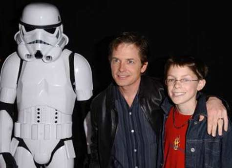 Michael J. Fox appears in a photo with his son from the Children's Aids Society Benefit Premiere for the 2002 movie 'Star Wars: Attack of the Clones' on May 12, 2002.