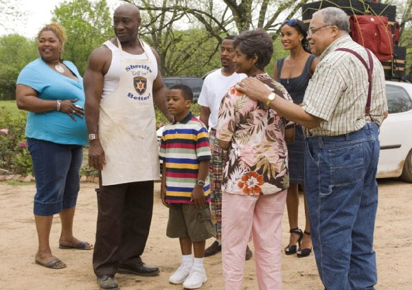 Monique, Michael Clarke Duncan, Damani Roberts, Martin Lawrence, Margaret Avery, Joy Bryant and James Earl Jones appear in a scene from the 2008 movie 'Welcome Home, Roscoe Jenkins.'