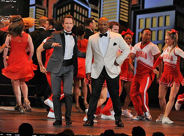 Mike Tyson and Neil Patrick Harris perform in the opening number  And, as if Harris&#39; opening number wasn&#39;t entertaining enough, the &#39;How I Met Your Mother&#39; actor was joined on stage by the one and only Mike Tyson.  The former boxer currently has his own Broadway show, &#39;Mike Tyson: The Undisputed Truth,&#39; which was directed by Spike Lee and written by Tyson&#39;s wife Kiki. <span class=meta>(CBS &#47; Heather Wines)</span>