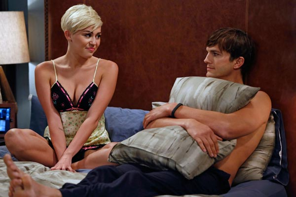 Ashton Kutcher appears with guest star Miley Cyrus in a scene from 'Two and a Half Men,' during an episode airing on Oct. 18, 2012.