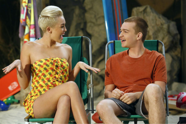 Jake &#40;Angus T. Jones, left&#41; and Missi &#40;special guest star Miley Cyrus, right&#41; appear on an episode of the CBS series &#39;Two and a Half Men&#39; that aired on Oct. 18, 2012. <span class=meta>(Greg Gayne &#47; Warner Bros. Television &#47; CBS)</span>