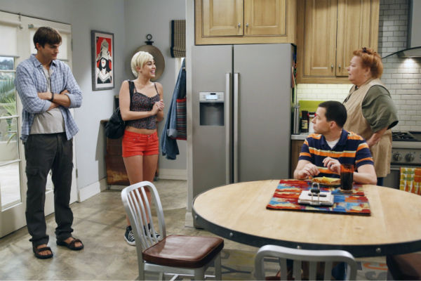 Walden &#40;Ashton Kutcher, left&#41; introduces Missi &#40;special guest star Miley Cyrus, center&#41; to Alan &#40;Jon Cryer, front right&#41; and Berta &#40;Conchata Ferrell, back right&#41;, on an episode of the CBS series &#39;Two and a Half Men&#39; that aired on Oct. 18, 2012. <span class=meta>(Greg Gayne &#47; Warner Bros. Television &#47; CBS)</span>