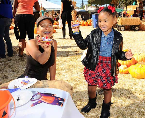 Christina Milian and daughter Violet attend the Pillsbury Make Halloween Sweet event at the Mr. Bones Pumpkin Patchm benefiting the L.A. Regional Food Bank, in Los Angeles on Oct. 11, 2013.
