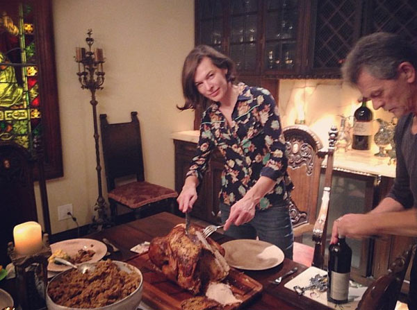"<div class=""meta ""><span class=""caption-text "">Milla Jovovich Tweeted this Instagram photo of herself carving a turkey on Thanksgiving - Nov. 22, 2012. She also posted a home video from her family's Thanksgiving dinner. (twitter.com/MillaJovovich/status/271817200678096896 / instagram.com/p/SW10wuTMii/)</span></div>"