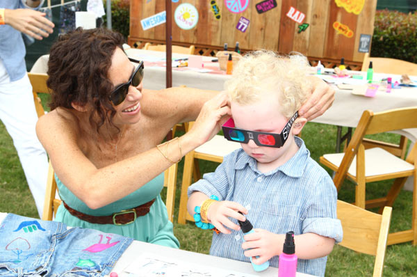 Minnie Driver and her son Henry appear at the 'Surfin' Safari-themed 77kids by American Eagle Denim Decorating Booth at the 22nd annual Elizabeth Glaser Pediatric Aids Foundation 'A Time For Heroes' Celebrity Picnic in L.A. on June 12, 2011.