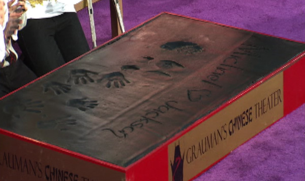 On this slab of wet cement, Paris Jackson wrote &#39;Michael [heart] Jackson] and placed her hands on it, as did her brothers, Prince and Blanket. They also created imprints of their late father&#39;s sequined glove and his dance shoes at the King of Pop&#39;s hand and footprint ceremony at the Grauman&#39;s Chinese Theatre on Jan. 26, 2012. <span class=meta>(OTRC)</span>