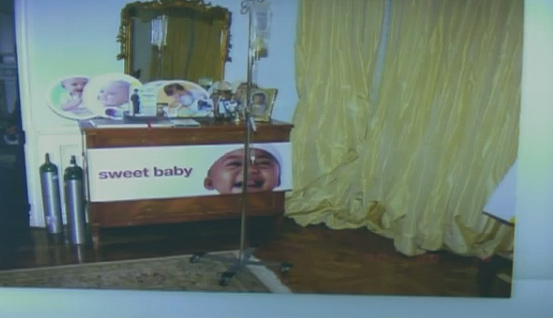 This picture was presented to the jury on Oct. 6, 2011, day 8 of Conrad Murray&#39;s involuntary manslaughter trial. A saline IV bag on a stand is seen in the room where Michael Jackson was found dead. A toxicologist testified that propofol was found was in the lower portion of the tubing and in a syringe. <span class=meta>(OTRC)</span>