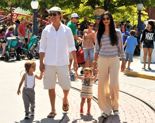 Matthew McConaughey and girlfriend Camila Alves stroll through Mickey's Toontown with their children, son Levi, 2, and daughter Vida, 1, on Wednesday, June 15, 2011.