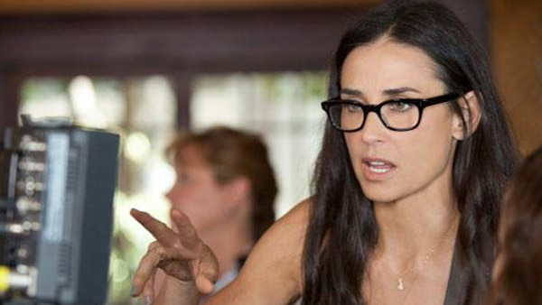 Demi Moore appears behind the scenes, directing...