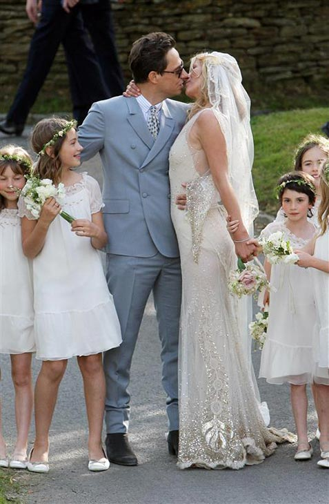 Supermodel Kate Moss married Jamie Hince on July 1, 2011 in Southrop, England. She wore a vintage, lace Galliano wedding gown.
