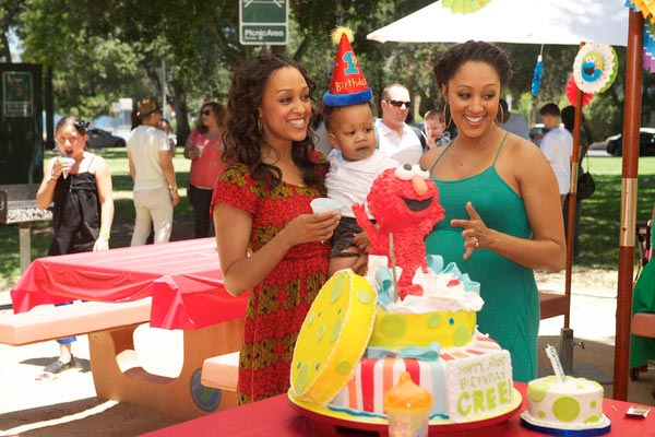 Tia Mowry Hardrict, her son Cree and her twin sister Tamera Mowry-Housley are pictured in a scene from their Style network series Tia and Tamera in an episode that aired on Oct. 23, 2012. - Provided courtesy of  Brandon Hickman / Style network / NBC Universal