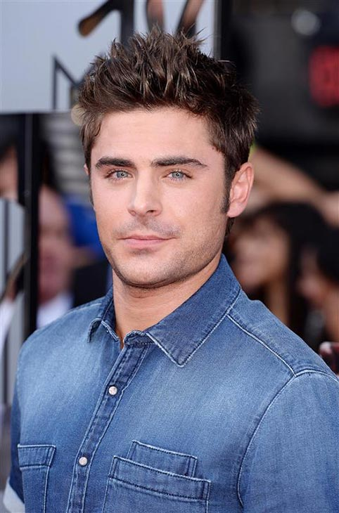 Zac Efron arrives at the MTV Movie Awards on Sunday, April 13, 2014, at Nokia Theatre in Los Angeles.