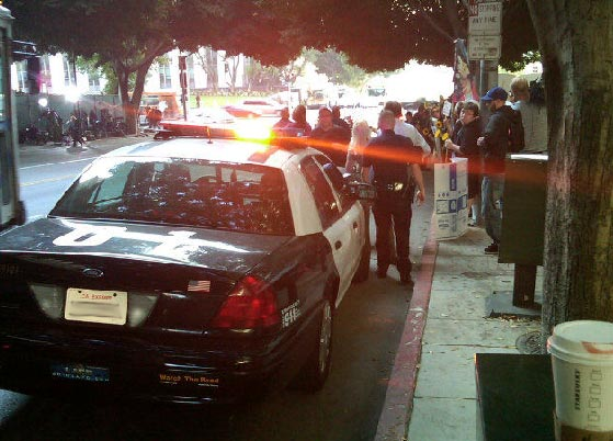 Sept. 27, 2011: A police officer parks his squad car outside the Los Angeles courthouse where Conrad Murray is on trial for involuntary manslaughter, following the 2009 death of Michael Jackson. <span class=meta>(OTRC)</span>
