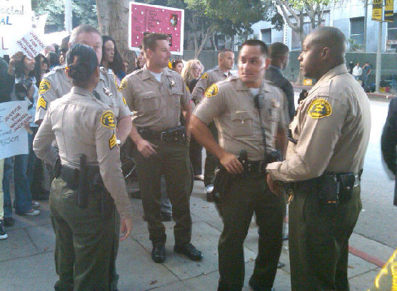 Sept. 26, 2011: Security guards stand outside the Los Angeles courthouse where Conrad Murray is on trial for involuntary manslaughter, following the 2009 death of Michael Jackson. <span class=meta>(OTRC)</span>