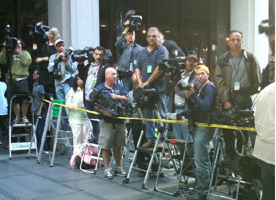 Sept. 27, 2011: Photojournalists stand outside the Los Angeles courthouse where Conrad Murray is on trial for involuntary manslaughter, following the 2009 death of Michael Jackson. <span class=meta>(OTRC)</span>