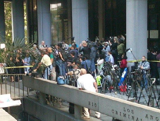Sept. 27, 2011: Photojournalists stand outside the Los Angeles courthouse where Conrad Murray is on trial for involuntary manslaughter, following the 2009 death of Michael Jackson.