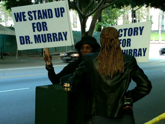 "<div class=""meta ""><span class=""caption-text "">Oct. 6, 2011: A Conrad Murray supporter stands outside the Los Angeles court where his involuntary manslaughter trial is taking place. (OTRC)</span></div>"