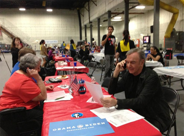 Singer Neil Diamond Tweeted this photo of himself 'Working the phones for Obama' at a pro-Obama phone bank in California, adding: 'If I call you, don't hang up. It's really me and I need you.'