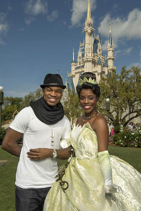 Ne-Yo poses with Princess Tiana Snow White at the Magic Kingdom park at the Walt Disney World Resort in Lake Buena Vista, Florida on Feb. 19, 2013.