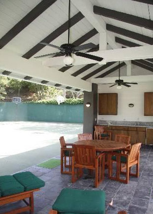 A dining area overlooking a basketball court at Jack Nicholson&#39;s Malibu estate. The three-bedroom, two-bathroom house lies of about 70 acres of land and was put on the market in the spring of 2011 for &#36;4.25 million. <span class=meta>(MLS &#47; Rodrigo Iglesias, Hilton &amp; Hyland)</span>