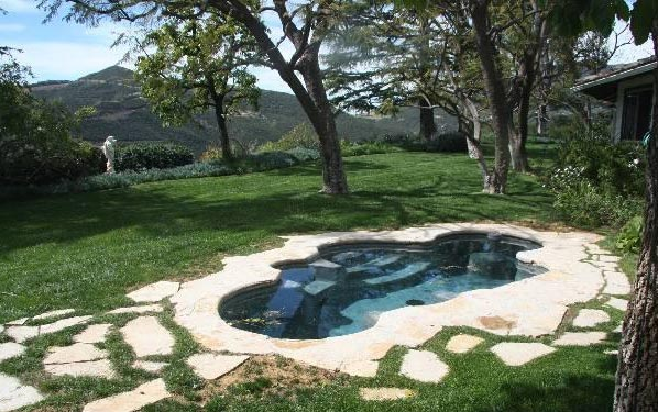 A pool inside Jack Nicholson&#39;s Malibu estate. The three-bedroom, two-bathroom house lies of about 70 acres of land and was put on the market in the spring of 2011 for &#36;4.25 million. <span class=meta>(MLS &#47; Rodrigo Iglesias, Hilton &amp; Hyland)</span>
