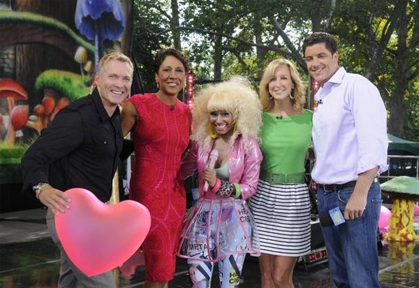Nicki Minaj appears alongside the hosts of 'Good Morning America' on ABC on Friday, Aug. 5, 2011.