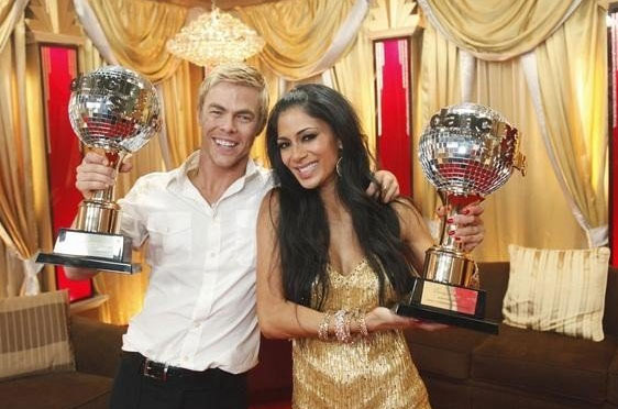 Nicole Scherzinger and Derek Hough celebrate...