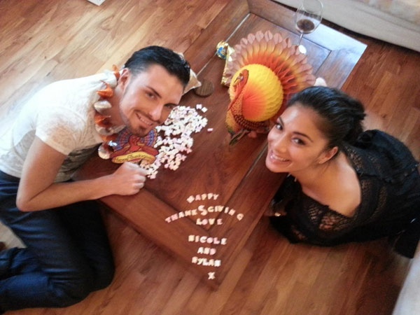 Singer and former Pussycat Dolls member Nicole Scherzinger Tweeted this photo of herself and Rylan Clark, a finalist on the UK version of &#39;The X Factor,&#39; on Nov. 22, 2012, saying: &#39;Happy Thanksgiving! Love Nicole and @RylanClark x .&#39;  Scherzinger is his mentor on the singing contest series. <span class=meta>(twitter.com&#47;NicoleScherzy&#47;status&#47;271636788467093505&#47;photo&#47;1)</span>