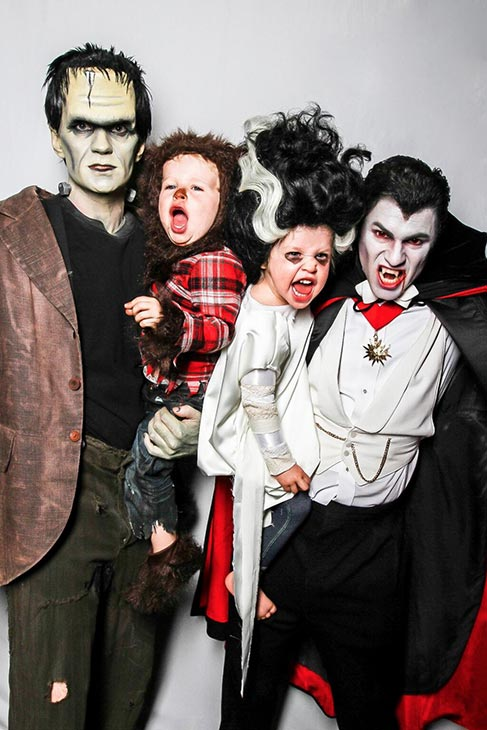 Neil Patrick Harris appears with fiance David Burtka and twins, Gideon and Harper, in a Halloween photo posted on his Twitter page on Oct. 31, 2013.