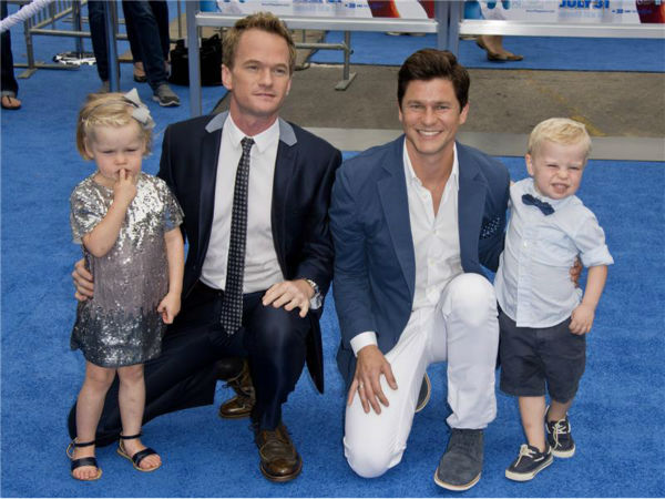 Neil Patrick Harris, partner David Burtka and their twins, Harper and Gideon, attend the premiere of 'The Smurfs 2' at the Regency Village Theatre in Westwood, near Los Angeles, on July 28, 2013.