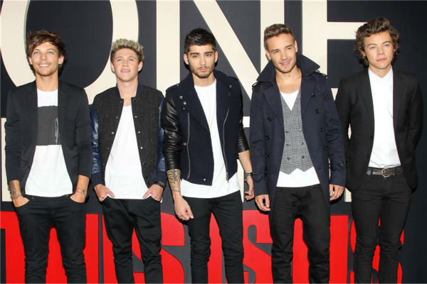 One Direction members Louis Tomlinson, Zayn Malik, Niall Horan, Liam Payne and Harry Styles walk the red carpet at the premiere of &#39;One Direction: This Is Us&#39; in New York on Aug. 26, 2013. <span class=meta>(Dave Allocca &#47; Startraksphoto.com)</span>