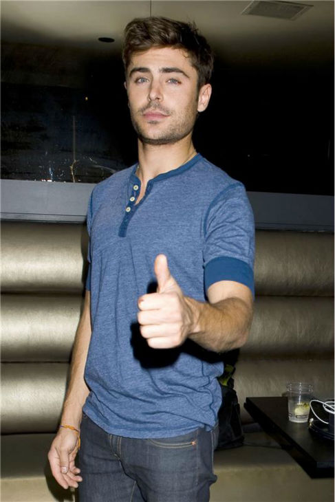 Zac Efron gives the thumbs up at a fan event for his latest film, the R-rated 'That Awkward Moment,' in Los Angeles on Oct. 15, 201