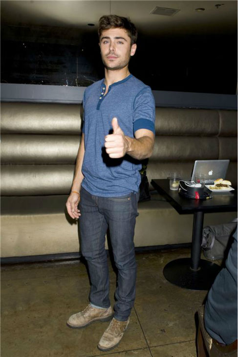 Zac Efron gives the thumbs up at a fan event for his latest film, the R-rated 'That