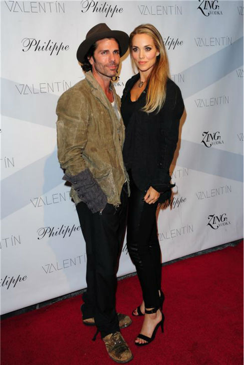 &#39;Dancing With The Stars&#39; season 17 contestant and actress Elizabeth Berkley and husband Greg Lauren attend a launch party for VALENTIN, her show partner Val Chmerkovskiy&#39;s urban streetwear couture brand clothing line, in Los Angeles on Oct. 17, 2013. <span class=meta>(Michael Simon &#47; Startraksphoto.com)</span>