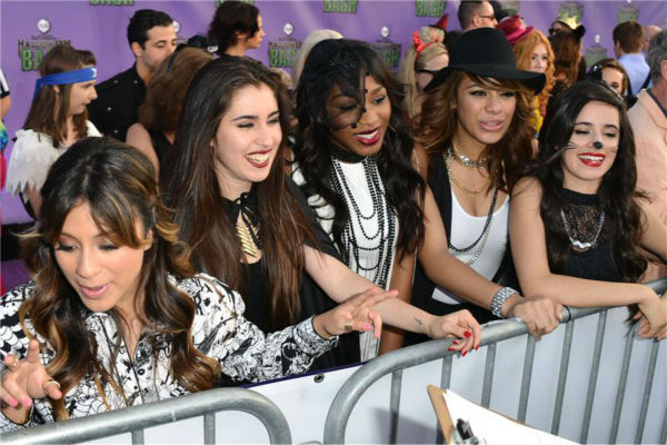 Members of the girl group Fifth Harmony attend the Hub Network's first annual Halloween Bash in Santa Monica, California on Oct. 20, 2013.