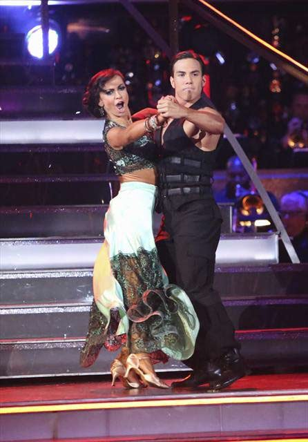"<div class=""meta image-caption""><div class=""origin-logo origin-image ""><span></span></div><span class=""caption-text"">Olympic speed skater Apolo Anton Ohno and his partner Karina Smirnoff received 29.5 out of 30 points from the judges for their  Tango on 'Dancing With The Stars: All-Stars,' which aired on November 12, 2012.  (ABC / OTRC)</span></div>"