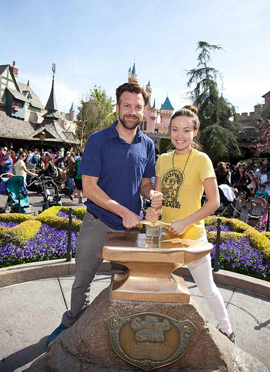 Newly-engaged couple Olivia Wilde and Jason Sudeikis try their luck at removing the 'Sword in the Stone' at Disneyland park in Anaheim, California on Tuesday, March 26, 2013. This was Wilde's first visit to a Disney theme park.