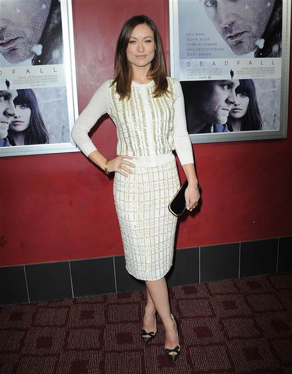 Olivia Wilde wears a white and gold L&#39;Wren Scott dress at a premiere of the film &#39;Deadfall&#39; in Los Angeles on Nov. 29, 2012. <span class=meta>(Hollywood Press &#47; Startraksphoto.com)</span>