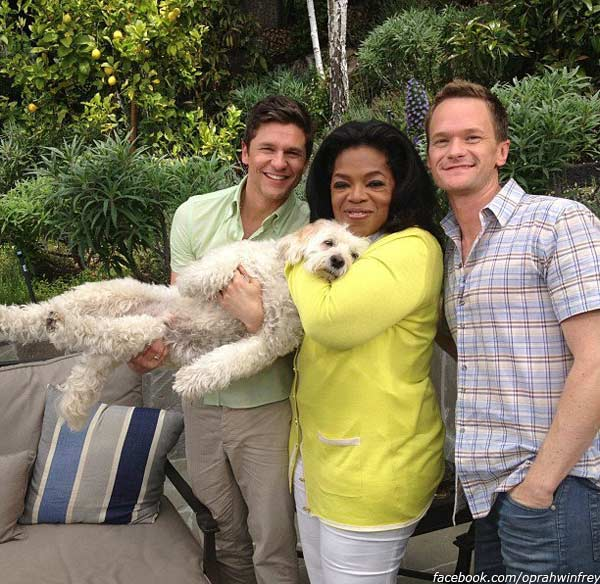 Oprah Winfrey posted this photo of herself with Neil Patrick Harris, his life partner David Burtka and their dog Watson on her Facebook page on May 2, 2012.