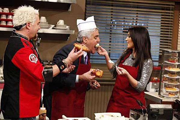 Kim Kardashian appears on 'The Tonight Show with Jay Leno' and cooks deep fried Oreos with Guy Fieri and Leno.